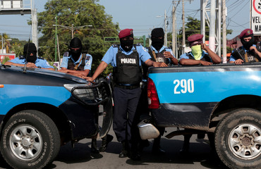 Police block the entrance of  Divine Mercy Catholic Church in Managua