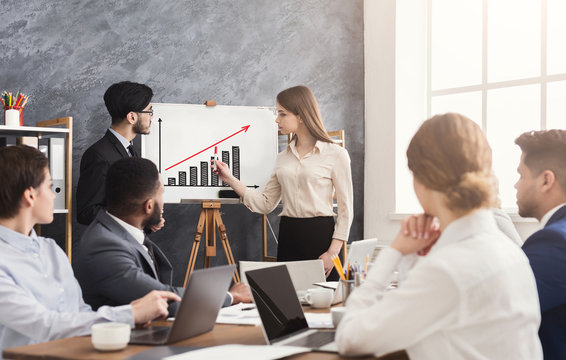 Business woman drawing profit growth graph