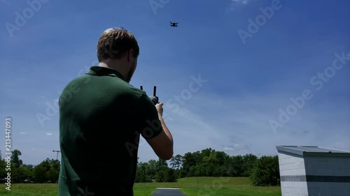 A man in a dark green shirt operates a remote controlled