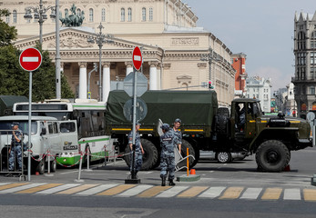 Members of the Russian National Guard block a street in front of the Bolshoi theatre in Moscow