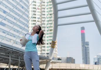 Young beautiful Asian model woman jogger running in morning