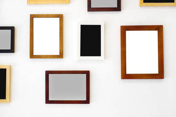 Blank wooden square photo frame modern interior design decorated on white wall background with copy space for text or image.