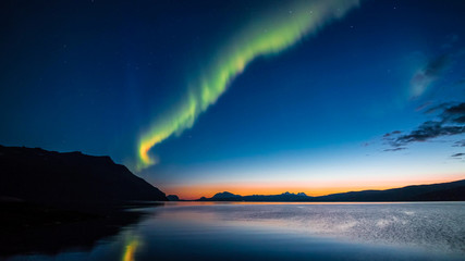 The beauty of the Aurora in Norway on the Aalesund archipelago or on the island of Svalbard in winter in September in the north