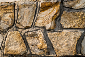 orange stones cemented wall backgroound