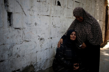 Relative of Palestinian teenager Loay Kheil, who was killed in an Israeli air strike, mourns during his funeral in Gaza City
