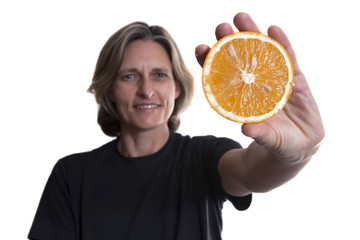 Woman holding a orange. Isolated on a white background.