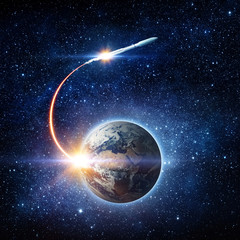 Rocket space ship launching from planet Earth and flying into outer space. Space exploration background. Elements of this image furnished by NASA.