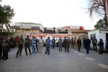 Iraqi security forces stands guard outside the main provincial government building Basra