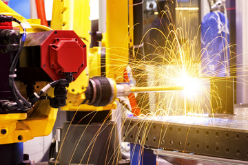 Motion Welding robots in factory with sparks, manufacturing, industry, factory
