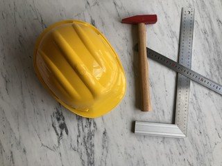 Construction architect items on marble floor