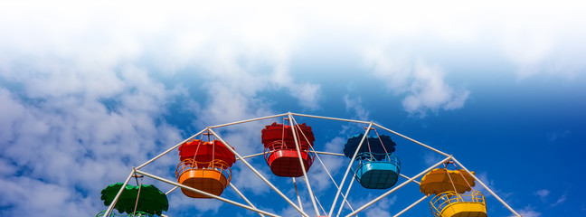 Ferris wheel against the blue sky.