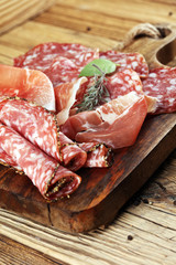 Food tray with delicious salami, raw ham and italian crudo or jamon. Meat platter with selection