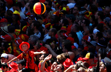 Belgian soccer team fans wait for the team to appear on the balcony of the city hall at the Brussels' Grand Place, after taking the third place in the World Cup 2018, in Brussels,