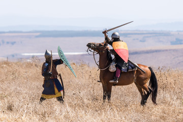 Reconstruction of Horns of Hattin battle in 1187. A rider from the Crusader army fights with a foot soldier from Saladin's army on the battlefield.