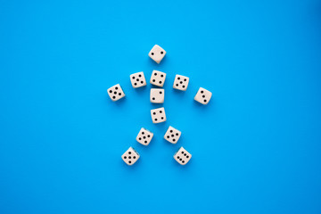 dice on a blue background in the form of a man
