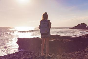 Girl enjoying sea / ocean scenery in Bali, Indonesia.