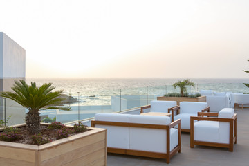 Sunset in cafe bar in sea hotel resort