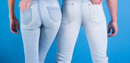 Jeans fashion always fashionable. Man and woman in white jeans on blue background. Beautiful jeans emphasize shapes. Jeans it for everyone, of any age, always in style. Couple in love holding an ass