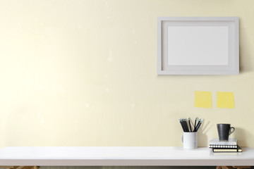 Contemporary workspace with supplies and mockup poster. workplace and copy space.