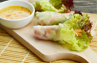 Salad roll with grilled fish and Peanut chili sauce (Thai name is Miang PLA POW).