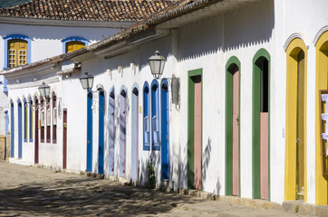 white houses with colored doors and windows in Paraty in Brazil