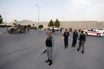 Afghan policemen arrive near the site of a blast in Kabul, Afghanistan