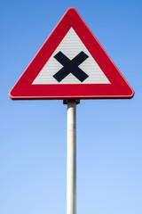 Dutch road sign: dangerous crossing