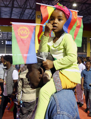 Child wears the Ethiopian and Eritrean national flags during a concert in Addis Ababa