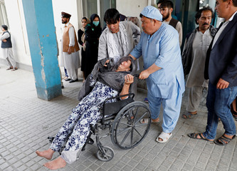 An Afghan woman mourns at the hospital after a blast in Kabul