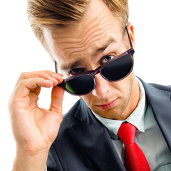 portrait of funny skeptic young businessman in sunglasses