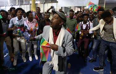 Residents carry the Ethiopian and Eritrean national flags in Addis Ababa