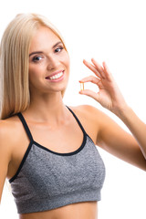 Woman with Omega 3 fish oil capsule, on white