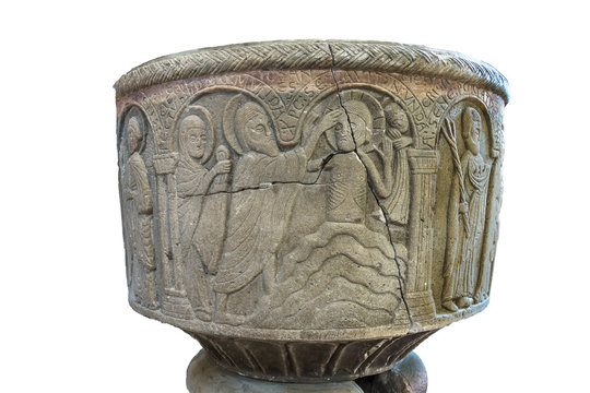 The Baptism of Jesus in the river Jordan on an isolated Baptismal font