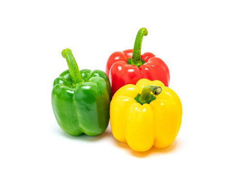 fresh colorful bell peppers isolated on white background
