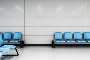 waiting hall with blue chairs