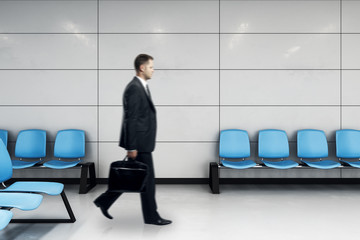 businessman with case in waiting hall