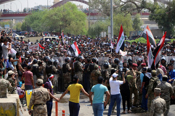 Protesters gather near the main provincial government building in Basra