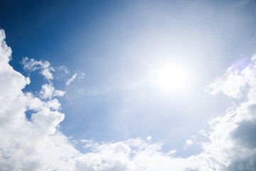 Sun and cloud on blue sky background
