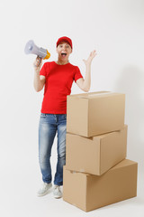 Full length portrait of delivery woman in red cap, t-shirt isolated on white background. Female courier screaming in megaphone near empty cardboard boxes. Receiving package. Copy space advertisement.