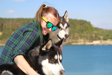 Photo of friends girl and two husky.