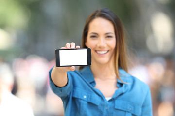 Woman showing a blank horizontal phone screen