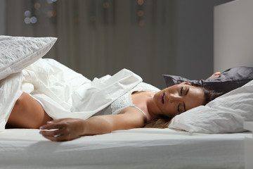 Woman sleeping deeply at home in the night