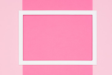 Abstract flat lay pastel pink colored paper texture minimalism background. Minimal template with empty picture frame mock up.