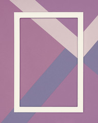 Abstract geometrical cold purple and ultra violet paper flat lay background. Minimalism and geometry template with empty picture frame mock up.