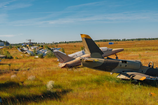 Abandoned broken old military fighter airplanes on grassy ground