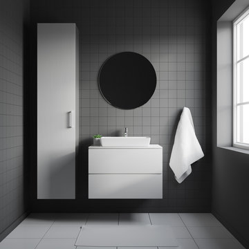 Dark bathroom interior with white sink on a white shelf and with round mirror hanging above it. 3d rendering