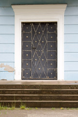 Photo of antique vintage old style forged decorated door