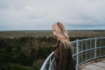 Woman enjoying the view from Lodbjerg Fyr, Denmark