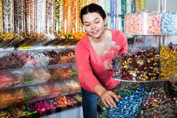 Woman in sweets shop