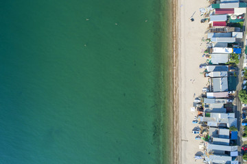 aerial view to beach with boat houses
